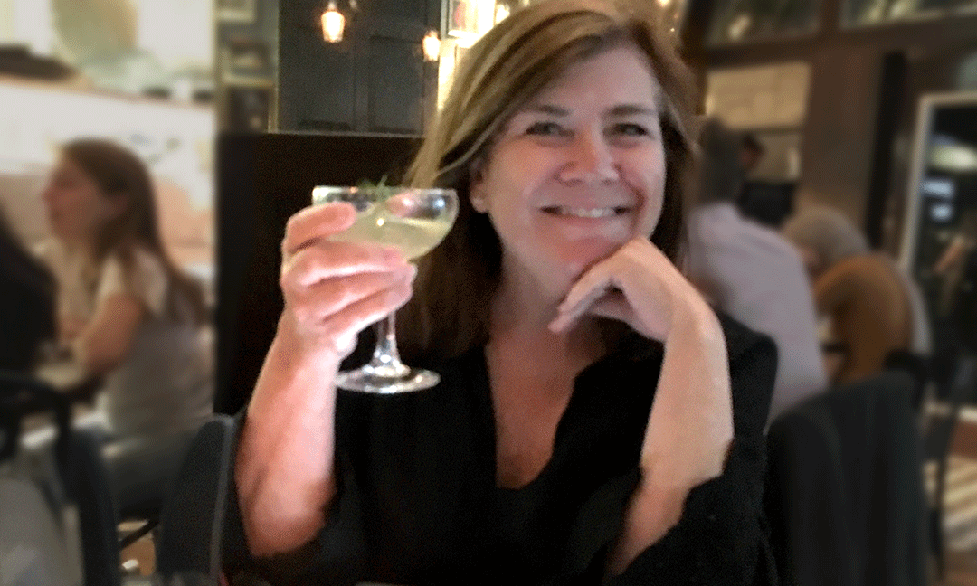 Photo of Karen Sinclair, owner of Sinclair & Co., celebrating the 30th anniversary of her company